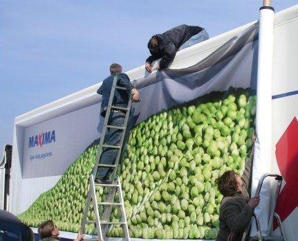 Crew Installing Fleet Graphics On A Truck