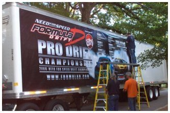 Crew installing Banner on Truck